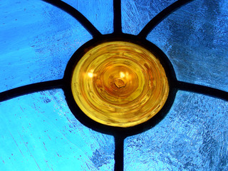 Orange circle sprouting lead channels in blue stained glass