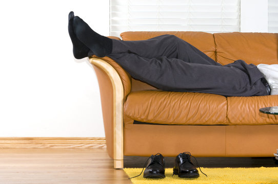 Business man is relaxing on the couch after a long week