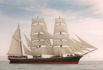 Wall Mural - Vintage windjammer style ship with full sails on the open sea