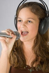 Young pretty girl singing.