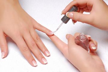 Poster de jardin Manicure Skin care. Applying of the Transparent varnish.