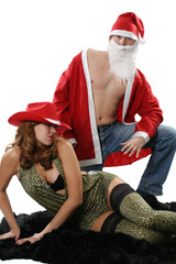 The sexual woman poses together with Santa