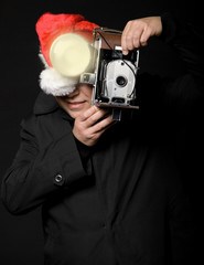 Santa photographer with vintage camera and flash