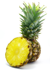 pineapple with its slice isolated on white background