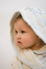 Portrait of child after by bath in a white dressing-gown