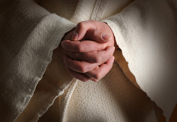 The hands of Jesus clasped in prayer