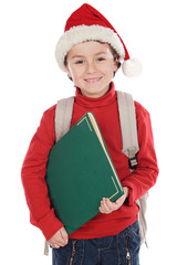 Adorable child studying with Santa Claus hat