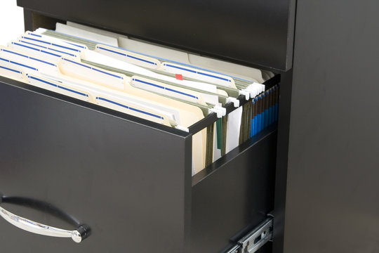black cabinet  with opened drawer with files in folders