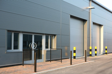 In de dag Industrial geb. Detail of new industrial unit/warehouse with steel cladding