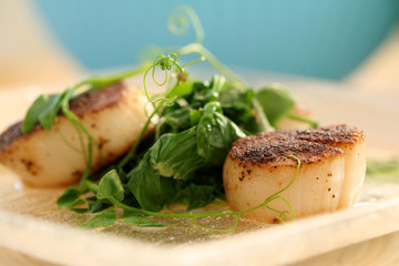 Seared Scallops and sauteed pea shoots
