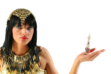 Ancient egyptian queen Cleopatra with bottle of perfume
