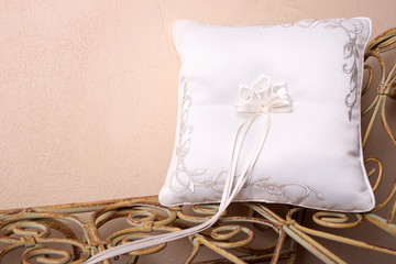 Ring Pillow on an old style rustic seat