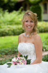 Beautiful blond bride with a happy grin on her face