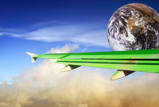 Globe with green airplane wing