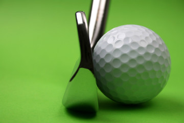 Golf Club and ball on a green background