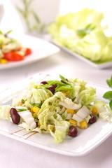 Fresh salad with corn and basil