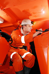 Miner in the drilling machine cockpit stock photo