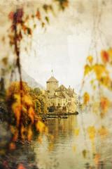 swiss castle beside lake in autumn gloomy weather