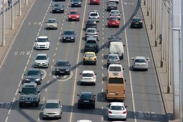 Heavy traffic on a main road over a bridge