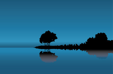Silhouette of a tree at dark blue coast