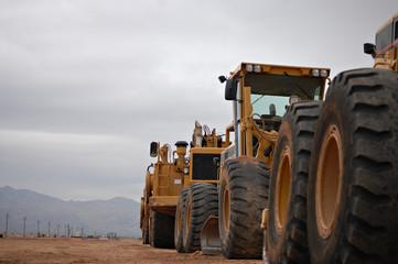 A row of bulldozers