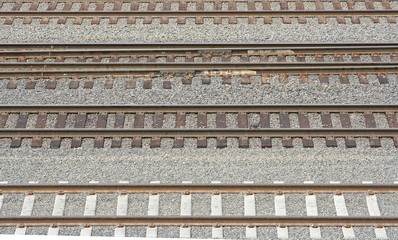 A group of four railroad tracks lying side by side