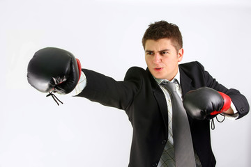 businessman over white boxing in suit with red gloves