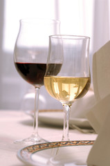 Red and white wine in stem glasses on table set up