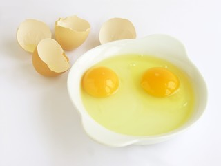 two raw hen eggs