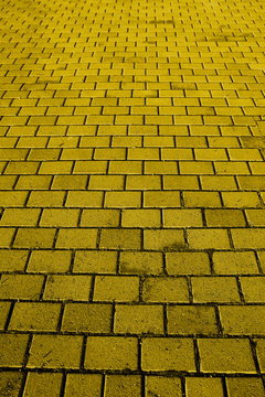 A background texture of a yellow brick road