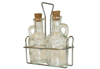 Two small decanters on a metal support.