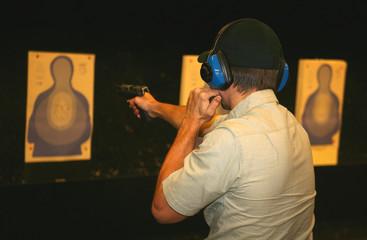 marksman on the range using a flashlight
