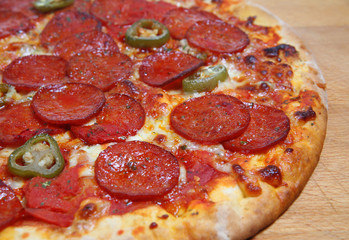 Pepperoni pizza with chiili peppers