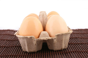 brown eggs against a bright white background