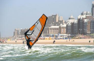 Wind surfer with backdrop of Scheveningen resort in Holland