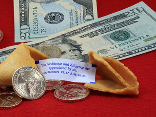 fortune cookies and money on the red closeup