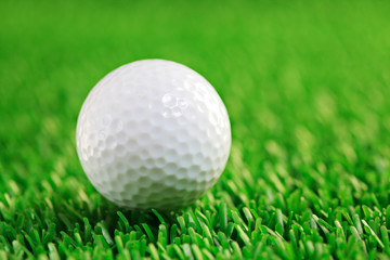 Golf ball against grass background