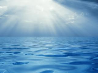 Solar beams above a quiet surface of ocean