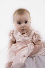 Portrait of a beautiful little six month old baby girl.