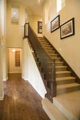 Spacious hallway with a modern staircase