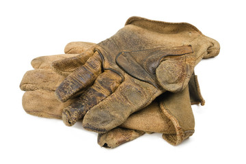 A pair of well worn leather rancher style leather work gloves