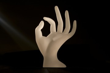 Sculpture of a hand with light rays shining on it