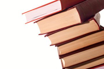 Stack of books over white