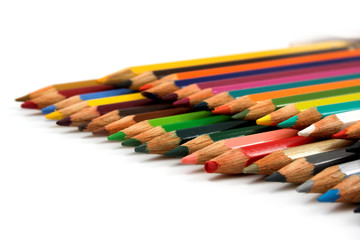 Assortment of coloured pencilson white background