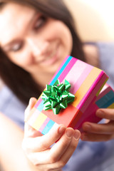 Beautiful young woman with gift box