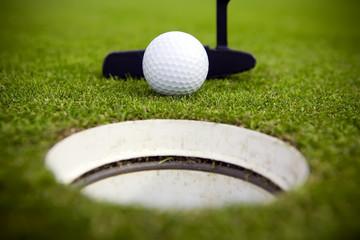 A golfer attempts to make a very short putt