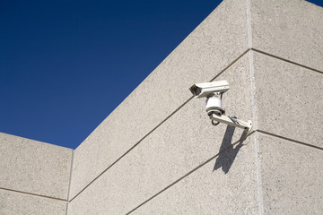 A security camera watches over a building