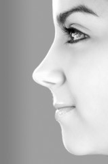 Profile portrait of a young and beautiful woman (toned in PS)