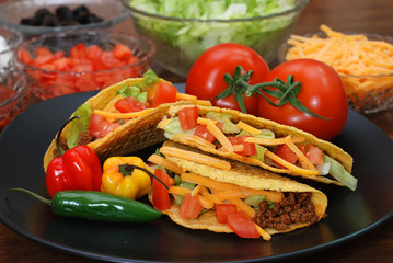 Prepared tacos with tomatoes, habanero and serano peppers