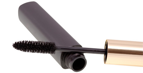 Close-up view to mascara with open brush on white background